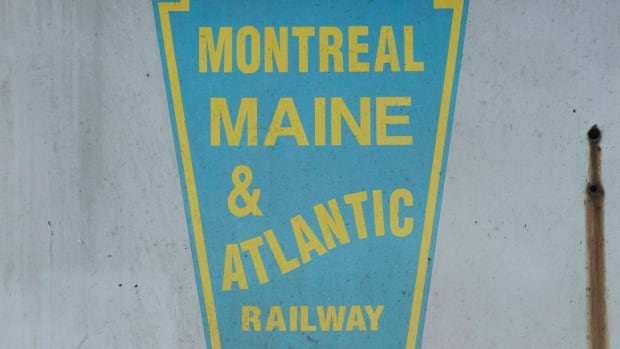 A logo for Montreal Maine and Atlantic railway is shown on a MM&A locomotive engine. The sale of the embattled railroad at the centre of the deadly Lac-Mégantic train derailment was approved on Thursday.