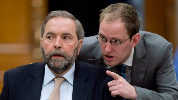 Executive Assistant George Smith, right, speaks with NDP Leader Tom Mulcair at a Commons committee meeting to into the party's use of House of Commons resources in May. The matter will be back before the Board of Internal Economy Tuesday.