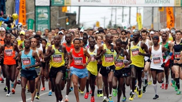 Thousands of runners take part at the start of the Ottawa Marathon, in Ottawa, Sunday, May 26, 2013.
