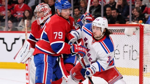 Andrei Markov (79) and the Canadiens open the NHL Eastern Conference final against Mats Zuccarello, right, and the Rangers on Saturday afternoon in Montreal.