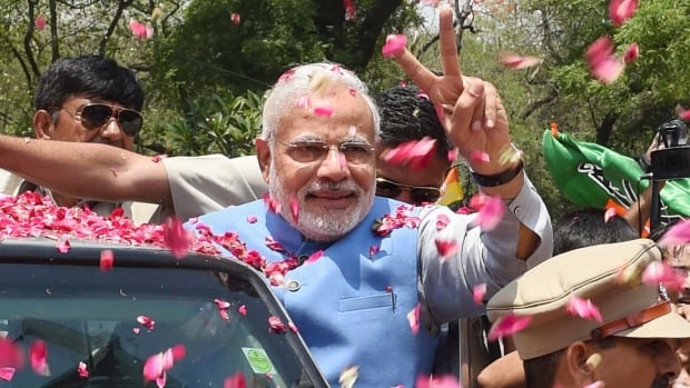 Supporters shower Bharatiya Janata Party (BJP) leader and India's next prime minister Narendra Modi with rose petals as he arrives at the party headquarters in New Delhi.