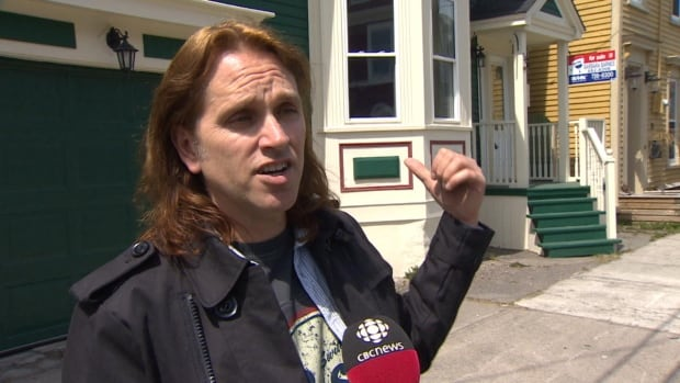 John Vatcher, executive producer of Republic of Doyle, stands in front of the house that's been used in the show.