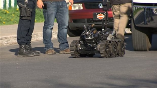 Police sent a bomb-defusing robot into an Ahuntsic-Cartierville home Saturday and in the wee hours of the morning on Sunday to dismantle explosive devices.