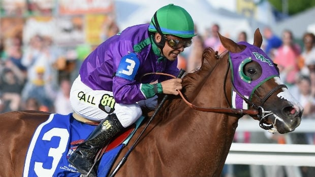 California Chrome, ridden by Victor Espinoza, races to the finish line to win the Preakness Stakes on Saturday.