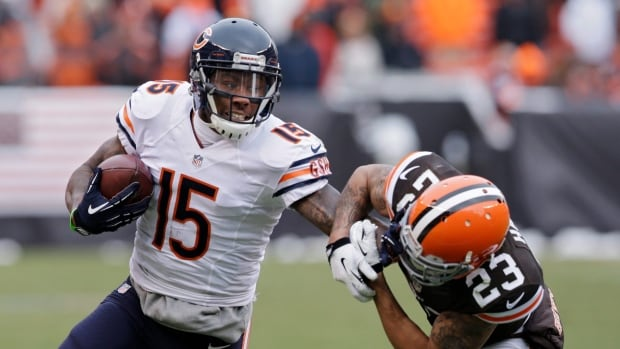 Chicago Bears wide receiver Brandon Marshall pushes Cleveland Browns cornerback Joe Haden away after a catch in the second quarter of an NFL game in December.