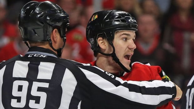 Blackhawks centre Andrew Shaw, right, is questionable for Wednesday's Game 2 against Los Angeles in the NHL Western Conference final. He missed the final five games of the previous series against Minnesota with an apparent right leg injury and sat out Sunday's