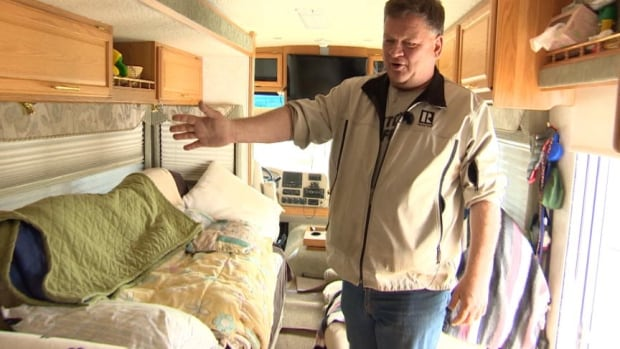 Brian Albert shows off the features of his RV, including two flat screen TVs.