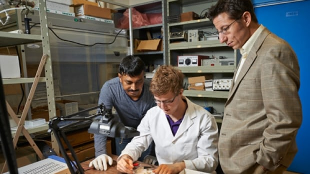 """University of Waterloo's Pavle Radovanovic (right) says his lab's has used nanotechnology to develop the """"holy grail"""" of light bulbs, that produces pleasing light at a reasonable cost."""
