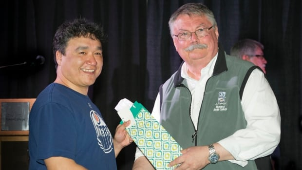 Rex Willie of Arctic Bay, Nunavut received an Outstanding Adult Educator award from Nunavut Arctic College president Mike Shouldice in Whitehorse last month. Willie was one of three northern adult educators to receive the award at the first ever Northern Adult Basic Education Symposium.