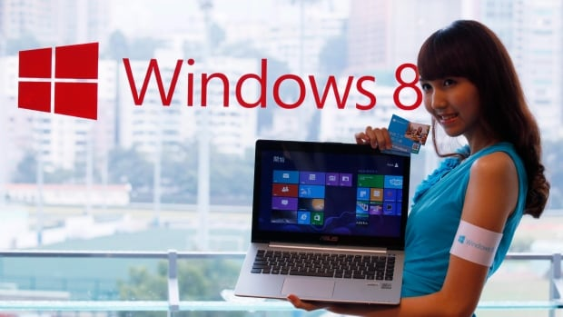 A model displays a laptop running Windows 8 during its launch in Hong Kong in 2012. China's Central Government Procurement Center issued the ban on installing Windows 8 on Chinese government computers last week.