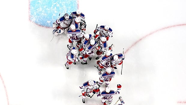 Henrik Lundqvist (30) of the New York Rangers celebrates with his teammates after defeating the Montreal Canadiens 3-1 in Game 2 of the Eastern Conference final on Monday in Montreal.