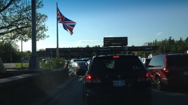 A Union Jack flies prominently on Victoria Day at the Hill Island crossing from New York State to Ontario. A Canadian flag hung in a less prominent position to its left.