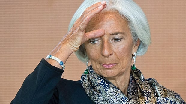 Moi? An icon of global patriarchal oppression? International Monetary Fund head Christine Lagarde, shown here waiting for a meeting with German Chancellor Angela Merkel last week.