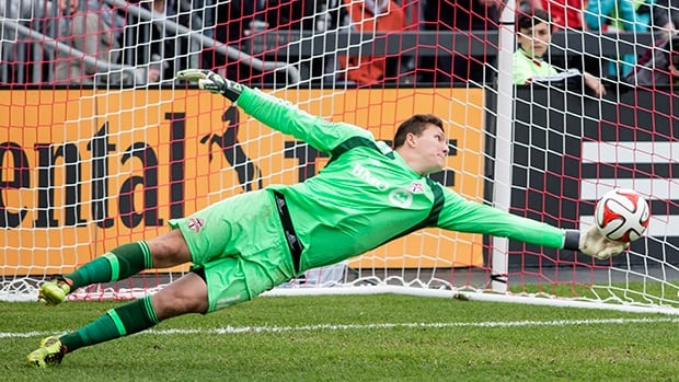 Toronto FC goalkeeper Joe Bendik tips away a shot during second half MLS soccer action against New York Red Bulls in Toronto on Saturday.