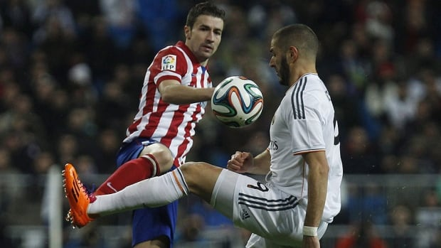 Real Madrid's Karim Benzema, right, seen here vying for the ball with Atletico's Gabi during a semifinal first leg of Copa del Rey soccer derby match in February, will do battle again in the Champions League final in Lisbon, Portugal.