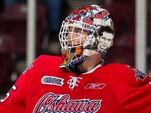 Peter Di Salvo wearing his Sum 41 goalie mask