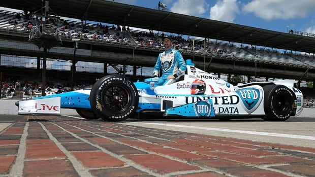 James Hinchcliffe of Oakville, Ont., poses for photographers during qualifying for the Indy 500 at Indianapolis Motor Speedway.