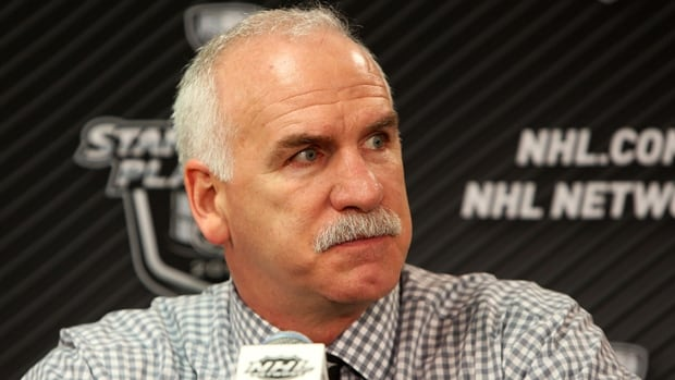 Chicago Blackhawks head coach Joel Quenneville glares at a reporter, unseen, asking a question follow a 6-2 loss in Game 2.