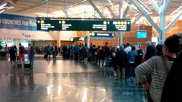 "David Leonard tweeted, ""A power outage means that YVR lines are outrageously long. Can't even see the front of it from here. I may walk home."""