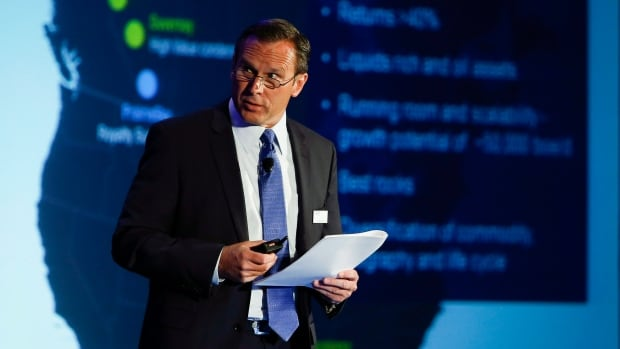 Doug Suttles, president and CEO of Encana, addresses the company's annual meeting in Calgary on May 13, 2014. Encana spun off its royalty unit PrairieSky on Thursday, pulling in $1.46 billion.
