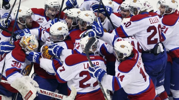 Edmonton Oil Kings Curtis Lazar (bottom centre) celebrates with teammates after scoring the winning goal against the Val-d'Or Foreurs on Friday in London, Ont.
