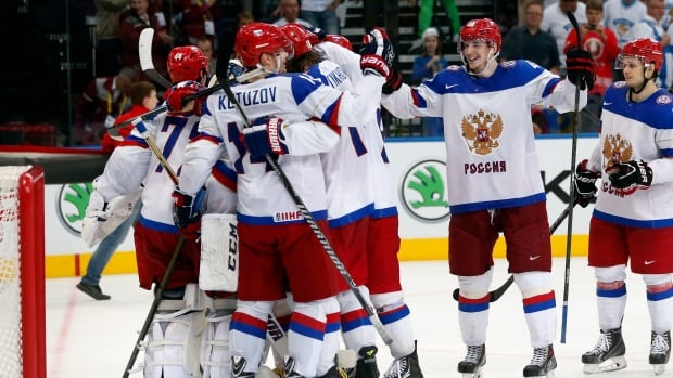 Russia players celebrate their victory in a semifinal match against Sweden in Minsk on Saturday.