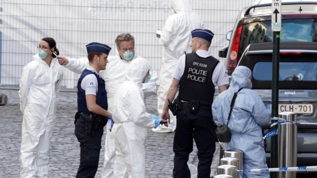 Forensic experts examine the site of a shooting at the Jewish Museum in Brussels. Belgian Foreign Minister Didier Reynders, in a post on Twitter, said he was 'shocked by the murders committed at the Jewish Museum.'