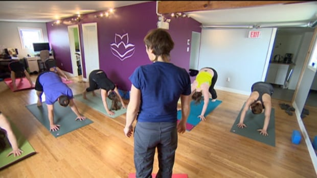 Christine Lamothe leads a class in her Saimavik Studio, the first yoga studio in Nunavut's capital city.