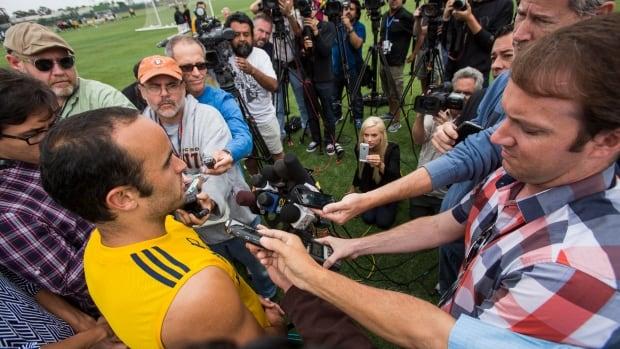 Los Angeles Galaxy forward Landon Donovan meets with the media horde after a  training session at StubHub Center in Carson, Calif., on Saturday.