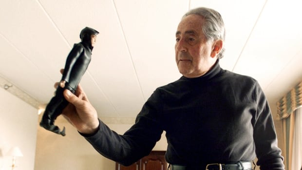 In this Jan. 30, 2003 file photo, G.I. Joe creator Don Levine holds up his original scuba diver G.I. Joe. Levine died of cancer on May 22, 2014 in Rhode Island, said his wife, Nan. He was 86.