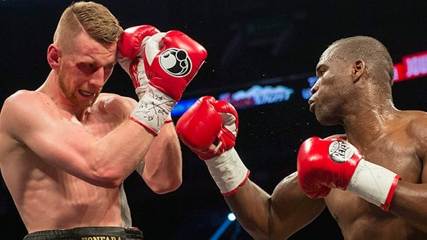 Adonis Stevenson right, and Andrzej Fonfara battle in a WBC light heavyweight title bout in Montreal on Saturday. Stevenson successfully defended his title, unanimously outpointing Poland's Fonfara.