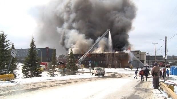 The old Polaris Theatre, one of the original buildings in Inuvik, N.W.T. was destroyed by flames yesterday. People in the community gathered to share memories as fire crews worked.
