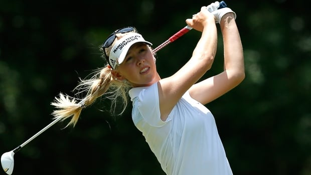 Jessica Korda uses a wood from the seventh tee box on the Crossings Course at Magnolia Grove in Mobile, Ala., on Sunday.