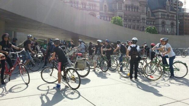 Cyclist line up in Nathan Phillips Square for the free pancake breakfast as part of Bike To Work Day.
