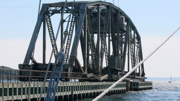 The Grand Narrows Bridge was built in 1890. The swing span is open in this photo to permit marine traffic.