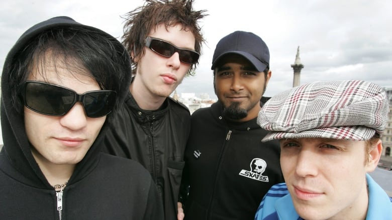 sum-41-band-members-pose-for-photo-in-lo