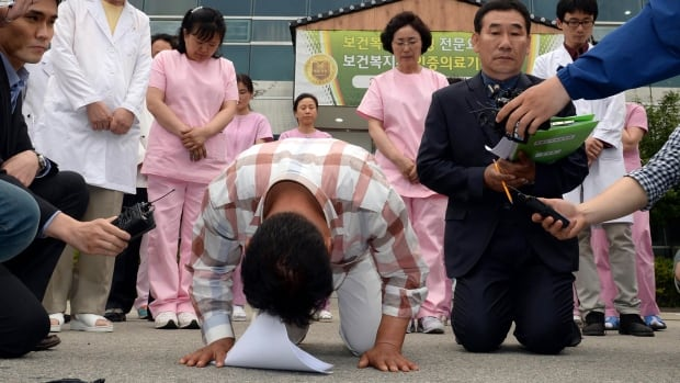 Employees at the Hyosarang Hospital bowed to apologize after a fire killed 20 patients and a nurse early Wednesday.