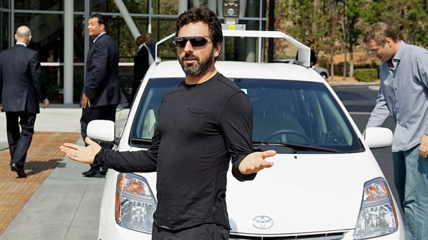 Google co-founder Sergey Brin shows off a driverless car, a modified Toyota, that the company has been tooling around in for a couple of years now at its Mountain View, Calif., campus. Google said in April 2014 that the cars can now negotiate thousands of urban situations that would have stumped them a year or two ago.