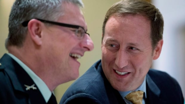 Maj.-Gen. Blaise Cathcart, left, with then defence minister Peter MacKay in January 2013, is under scrutiny by legal regulators after an apparent failure to comply with the National Defence Act for three years running.