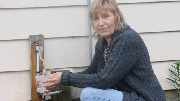 Sonja Rueck says her neighbours property has contaminated her well water in Watson Lake, Yukon. She says the water smells and tastes like gasoline.