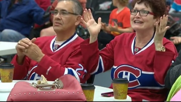 Barbara Bourque reacts as she watches the Montreal Canadiens play on the big screen at the Bold Centre in Lac La Biche on Thursday night.
