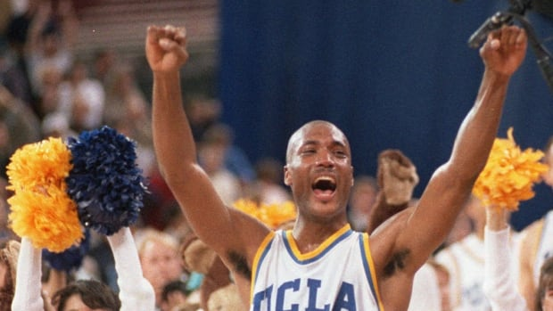 In this April 3, 1995 photo, UCLA's Ed O'Bannon celebrates after his team won the  championship NCAA game. O'Bannon has helped spearhead the lawsuit.