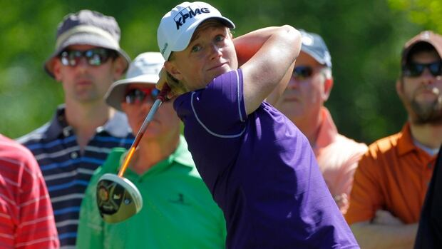 Stacy Lewis hits a shot from the ninth tee box in the second round of the ShopRite LPGA Classic in Galloway, N.J., on Saturday.