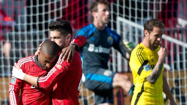 Jermain Defoe, left, is hugged by Toronto FC teammate Jonathan Osorio after scoring in a 3-2 win over Columbus on Saturday.