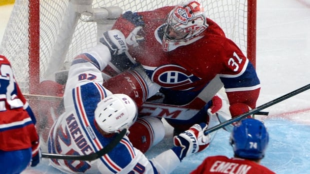Chris Kreider (20) of the Rangers collides with Canadiens netminder Carey Price (31) in Game 1 of the Eastern Conference final.