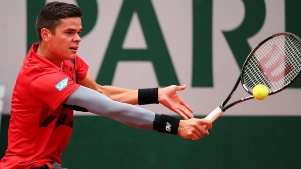 Canada's Milos Raonic returns a shot during his men's singles match against Marcel Granollers of Spain at Roland Garros on Sunday. Raonic became the first Canadian man in the Open era to reach the quarter-finals of a Grand Slam tournament.
