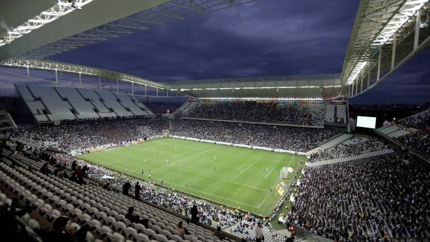 Corinthians's and Botafogo players battle it out during a Brazilian soccer league match at the Itaquerao, the stadium that will host the World Cup opener.