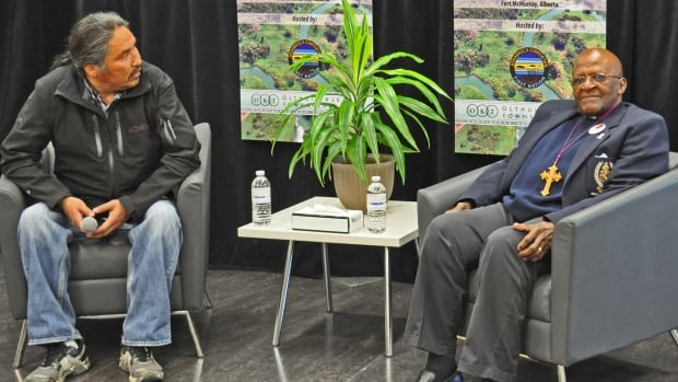 Archbishop Desmond Tutu with Athabasca Chipewyan Chief Allan Adam on May 30 in Fort McMurray.