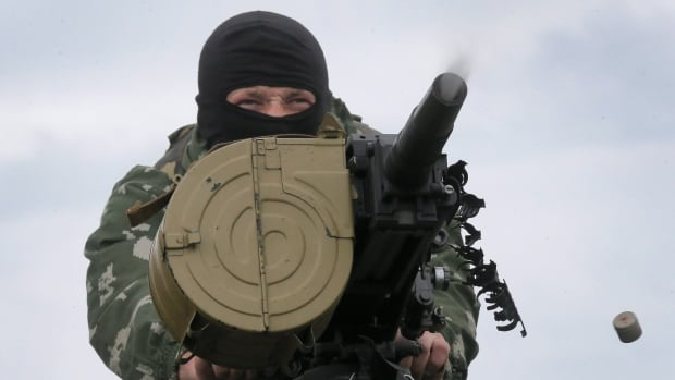 A Ukrainian soldier shoots from a grenade launcher during a battle with pro-Russian fighters at Slovyansk this weekend. An attack in the country's east by around 100 insurgents was met by firing from the border guards on Monday.