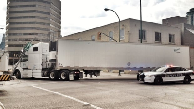 A semi-trailer unit went too wide on a turn downtown and knocked over a traffic light.